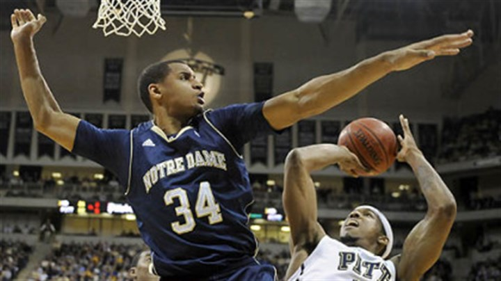 Carleton Scott and Gilbert Brown Notre Dame's Carleton Scott blocks a shot by Pitt's Gilbert Brown Monday at the Petersen Events Center.