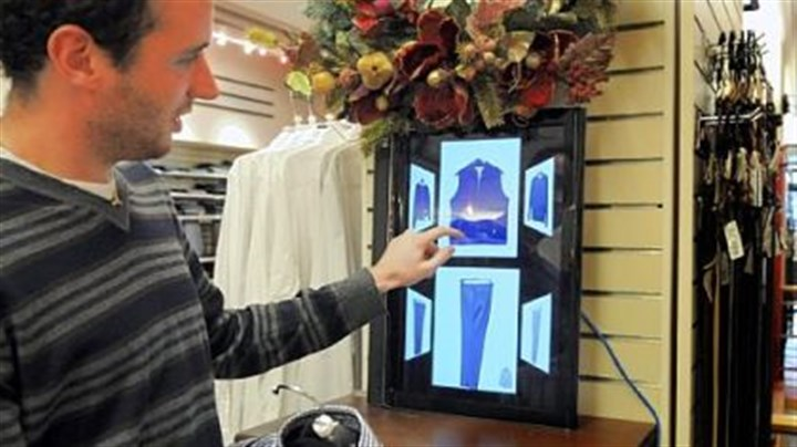 Carnegie Mellon student Philip Croul Carnegie Mellon student Philip Croul demonstrates how to use a Smart.Mirror to help coordinate clothing in the Charles Spiegel for Men store in Squirrel Hill.