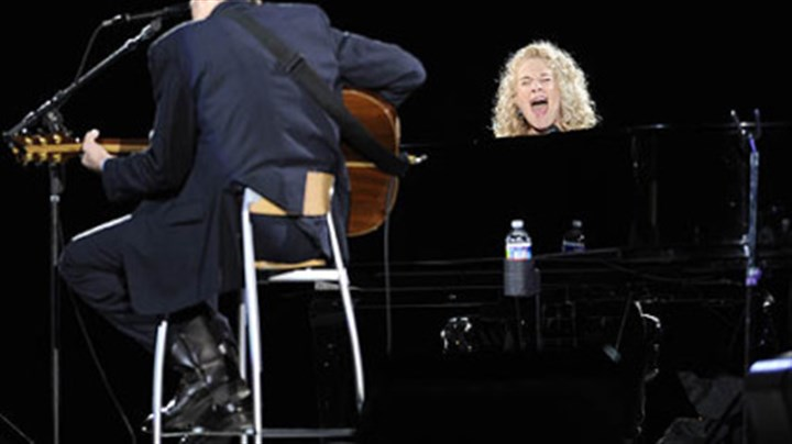 Carole King and James Taylor together Carole King, right, and James Taylor perform together at the Mellon Arena.