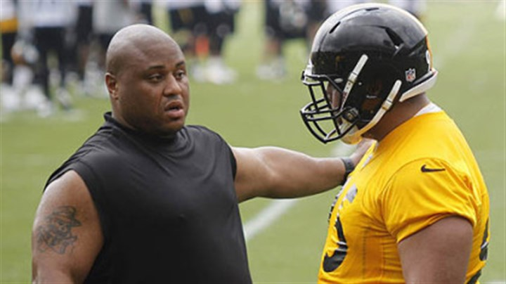 Casey Hampton Veteran Casey Hampton, left, explains something to rookie Alameda Ta'amu during the team's minicamp this week.