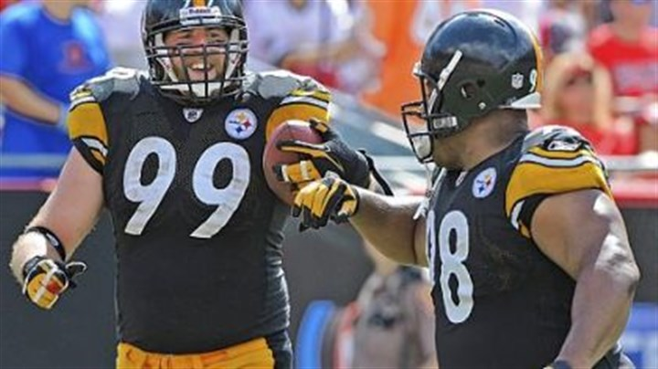Casey Hampton and Brett Keisel Defensive end Brett Keisel gets a congratulatory bump from Casey Hampton after Keisel returned an interception 79 yards for the Steelers' final touchdown of the game.