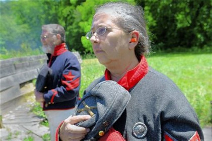 Cathy Griffey Cathy Griffey and her husband Don pause in June to remember soldiers wounded or killed during the Battle of Bedford at Old Bedford Village.