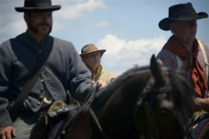 Cavalry at rest Robin Shields of Slickville, Pa., center, is a Civil War cavalry re-enactor in her spare time. She is also a hospice nurse and said her patients enjoy the stories she tells from re-enactments.