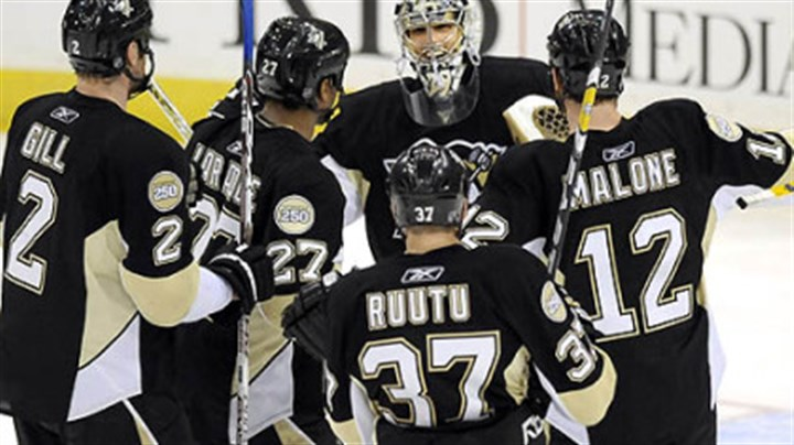Celebrate Penguins Marc-Andre Fleury gets congratulated by teammates after defeating the Flyers Sunday.