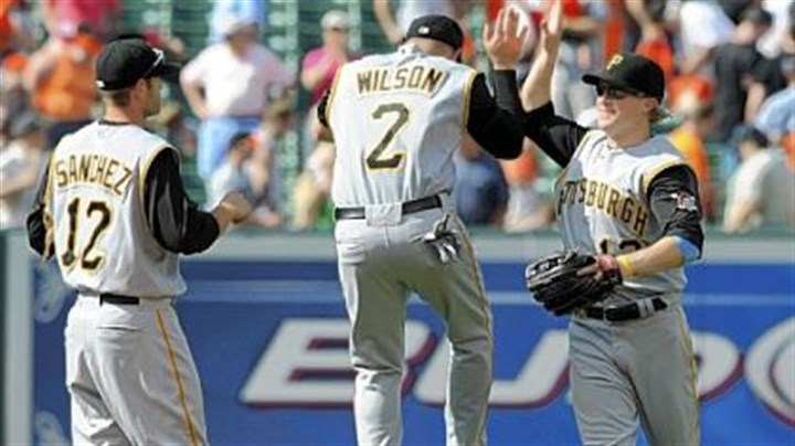 Celebrate! Pirates' Freddy Sanchez, Jack Wilson and Nate McLouth celebrate their 5-4 win.
