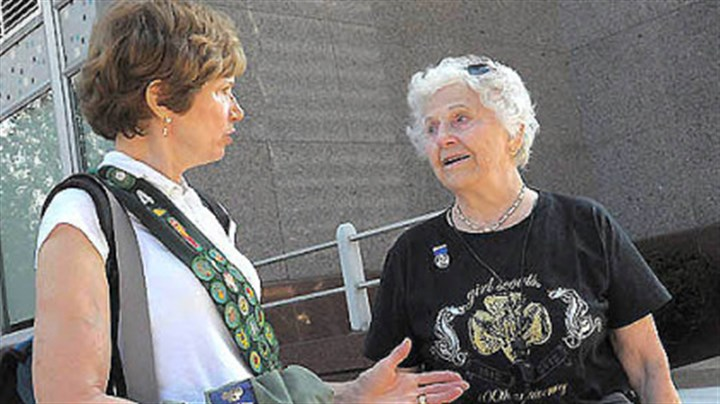 "Celebrating Girl Scouts' first century Virginia Halt, 92, shown here at right with her daughter Sandra Fischer, was honored by the Girl Scouts for more than 30 years of service as part of today's parade Downtown celebrating the organization's 100th anniversary. The parade theme was ""100 Years of History and a Future of Possibilities."""