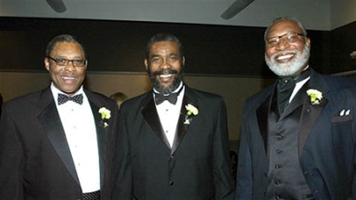 Celebrating his place in Steelers history Former Steelers Dwight White, Joe Green, and L.C. Greenwood share a moment at the Steelers 75th Gala event at the David L. Lawrence Convention Center in 2007