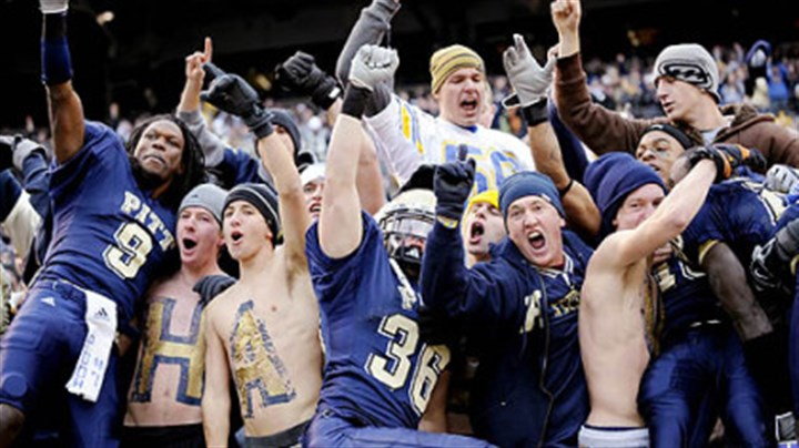 Celebration Pitt's T.J. Porter, left, and Mike Toerper jump into the stands after defeating West Virginia, 19-15, in the Backyard Brawl yesterday at Heinz Field.