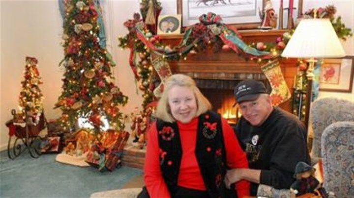 Celine and Bill Wilson Bill and Celine Wilson have set up 11 Christmas trees at their Upper St. Clair house.