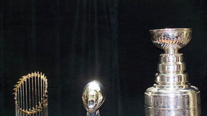 Championship trophies From left, the World Series, Vince Lombardi (NFL) and the Stanley Cup (NHL) championship trophies.