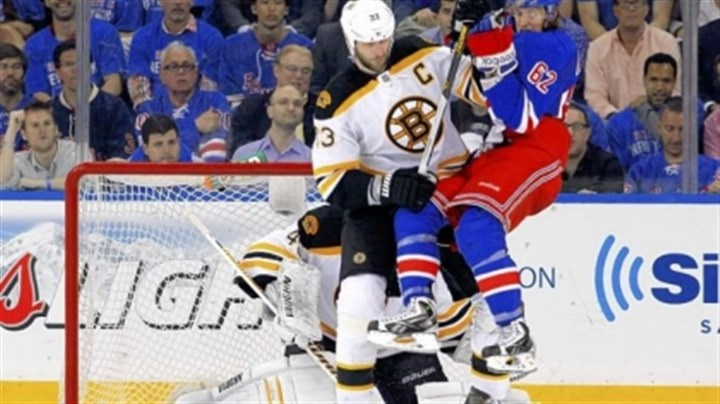 chara Boston's Zdeno Chara checks the Rangers' Carl Hagelin in Game 3 of the Eastern Conference semifinal May 21 in New York.