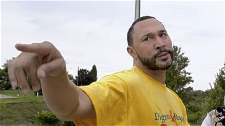Charlie Batch speaks Charlie Batch speaks with reporters outside Monessen High School, where he attended a student assembly to speak about the importance of dignity and respect.