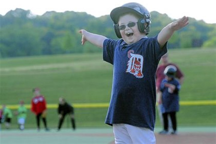 Charlie Osborn Charlie Osborn signals himself safe at first base during a Miracle League game in Murrysville.
