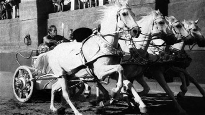 "Charlton Heston as Ben Hur at the reins of chariot Charlton Heston, in the title role, drives his chariot toward the finish line in a scene from the Metro-Goldwyn-Mayer 1960 film ""Ben-Hur."" The spectacular movie was based upon Gen. Lew Wallace's classic novel. Heston, who won the 1959 best actor Oscar for his chariot-racing ""Ben-Hur"" portrayed Moses, Michelangelo, El Cid and other heroic figures in movie epics of the '50s and '60s."