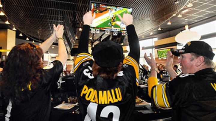 Cheering at Grille 36 Steelers fans at Jerome Bettis' Grille 36 on the North Shore: