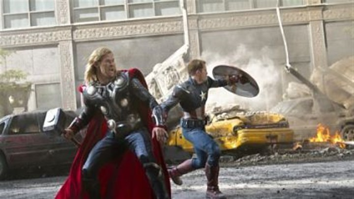 "Chris Hemsworth as Thor, left, and Chris Evans as Captain America Chris Hemsworth as Thor, left, and Chris Evans as Captain America join other superheroes to save the Earth in ""Marvel's The Avengers"""