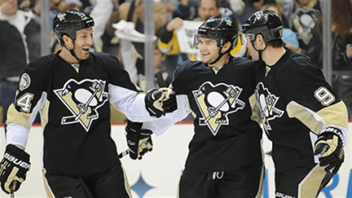 Chris Kunitz, Brooks Orpik and Pascal Dupuis Penguins forward Chris Kunitz, center, celebrates a goal with defenseman Brooks Orpik, left and Pascal Dupuis in the first period of Wednesday's game against the Lightning at Consol Energy Center.