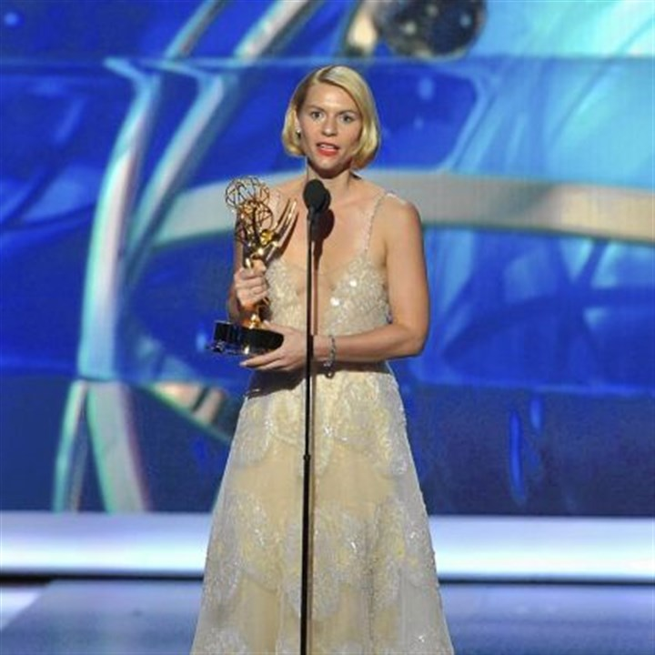 "Claire Danes at 2013 Emmys Clair Danes accepts the award for outstanding lead actress in a drama series for her role on ""Homeland."""