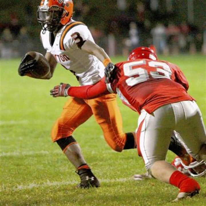 Clairton's Clifford Raymone Clairton's Clifford Raymone avoids a tackle by Fort Cherry's Trevor McIntyre on his way to a touchdown Friday at Fort Cherry.