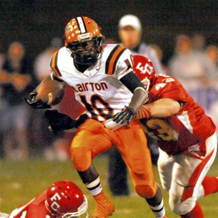 Clairton's Lamont Wade Clairton's Lamont Wade runs past Fort Cherry's John Findling (43) and Scott Miller Friday at Fort Cherry. Clairton won, 36-28.