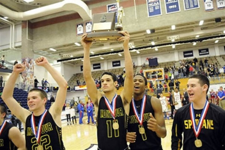 Class AAA-1 Montour's Devin Wilson holds the trophy with his teammates after defeating Chartiers Valley in the WPIAL class AAA championship Friday night at Palumbo Center.
