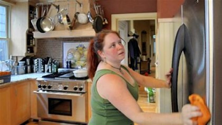 cleaning the fridge Mrs. Kniess uses an eco-friendly commercial glass cleaner on the stainless refrigerator. A quick buff after cleaning removes residue that could leave streaks.