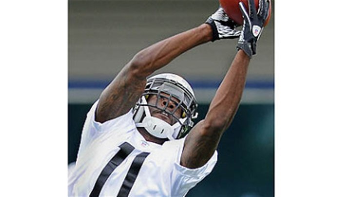 Clemons Toney Clemons goes up for a pass on Day 2 of rookie orientation camp.