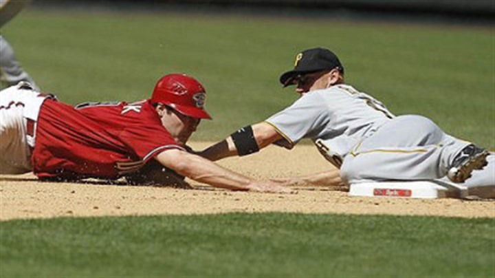 Clint Barmes and A.J. Pollock Pirates' Clint Barmes tags Arizona Diamondbacks' A.J. Pollock who slid past second base on a steal-attempt during the seventh inning.