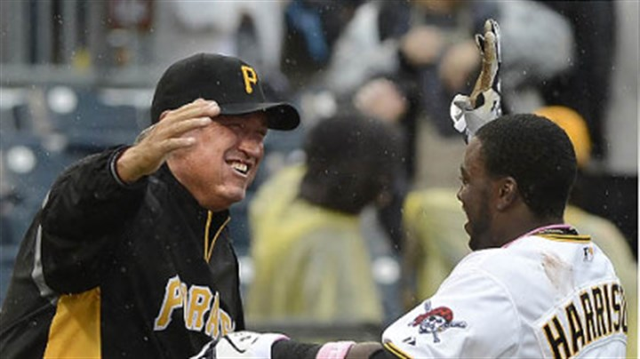 Clint Hurdle and Josh Harrison Manager Clint Hurdle greets Josh Harrison after Harrison's walk-off single in the 12th inning.