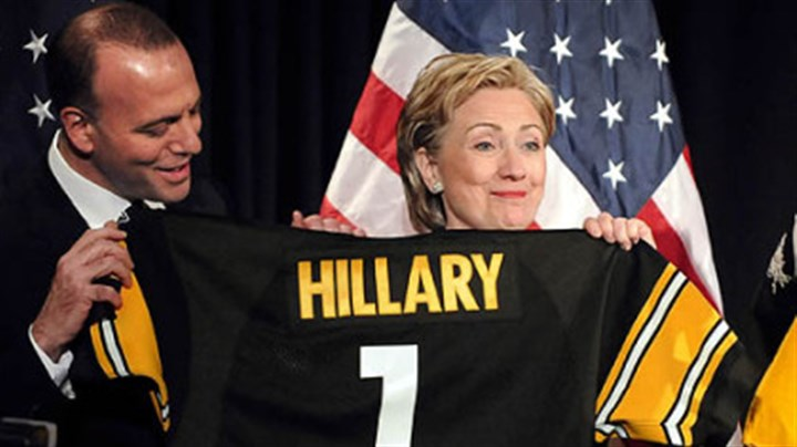 Clinton with Onorato Sen. Hillary Rodham Clinton shows off a Steelers Jersey presented to her as Dan Onorato looks on at the Allegheny County Democtratic Committee dinner at Heinz Field last night.