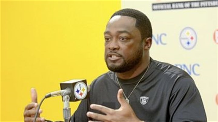 Coach Tomlin Steelers coach Mike Tomlin speaks to the media earlier this month at the team's South Side training facility.