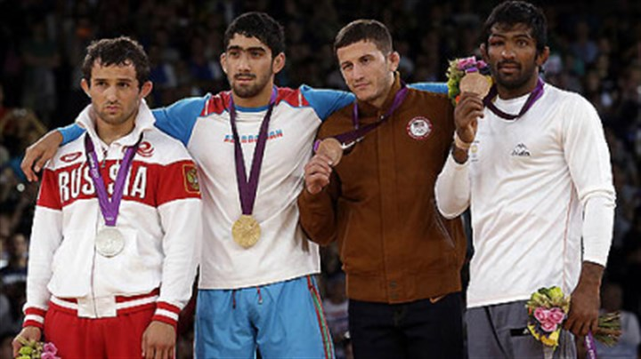 Coleman Scott wins bronze The medalists pose after the men's 60-kg freestyle wrestling competition. From left to right: silver medalist Besik Kudukhov of Russia, gold medalist Toghrul Asgarov of Azerbaijan, bronze medalist Coleman Scott (from Waynesburg) of the United States and bronze medalist Yogeshwar Dutt of India.