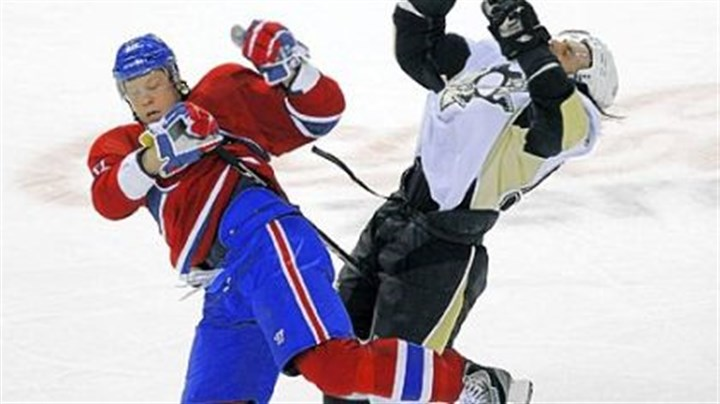 Collision The Canadiens' Andrei Kostitsyn, left, collides with Kris Letang Saturday in Montreal.