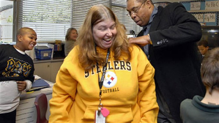 Community work celebrated Dwight White signs teacher Marlene Berncic's sweatshirt during a visit to Pace School in Churchill. The school held a ceremony to thank the former Steeler for his support of the institution.