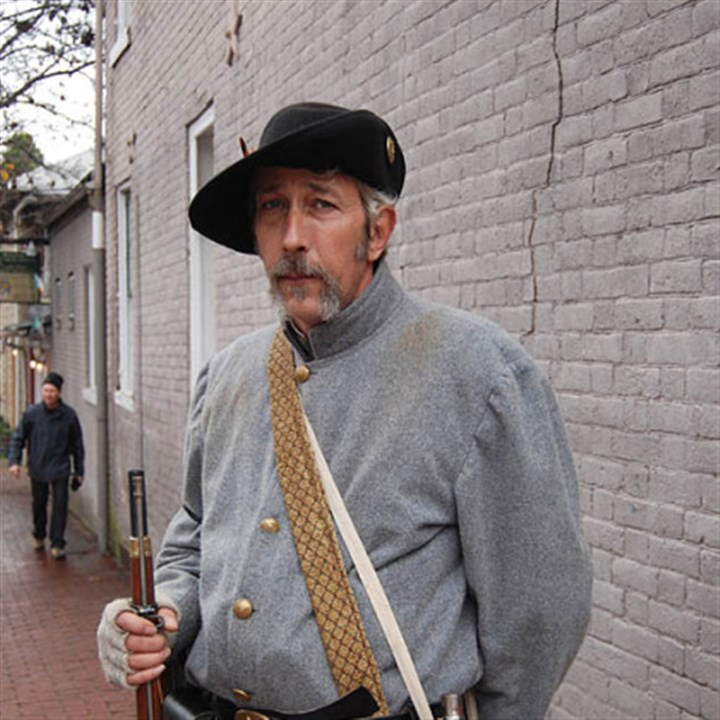 Confederate re-enactor Jimmy Fowler of Fredericksburg has been a Civil War re-enactor for three years. He was standing guard on Hanover Street during street fighting at the 150th anniversary of the Battle of Fredericksburg.