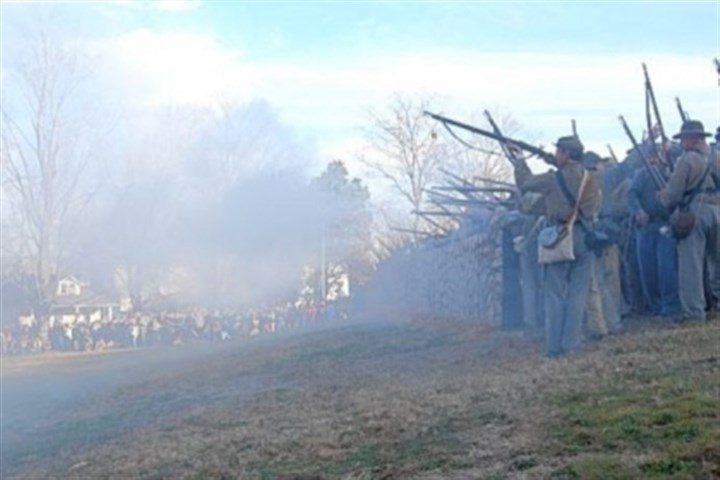 Confederate riflemen Confederate riflemen fire from behind a replica of the stone wall at the base of Marye's Heights, where the worst of the fighting occurred Dec. 13, 1862, during the Battle of Fredericksburg, Va.