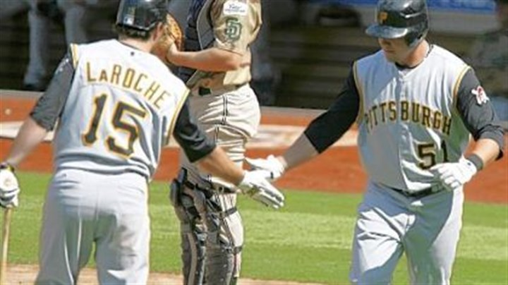 Congratulations Steve! Padres catcher Nick Hundley looks down as Pirates' Andy LaRoche, left, congratulates teammate Steve Pearce after Pearce hit a home run yesterday in the fourth inning.