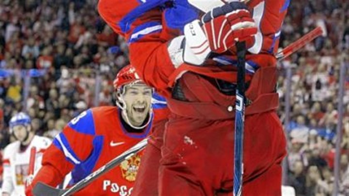 Congratulations Pavel Datsyuk watches as Alexander Ovechkin congratulates Evgeni Malkin after Malkin scored a goal for Russia in the first period of Sunday's preliminary round game against the Czech Republic.