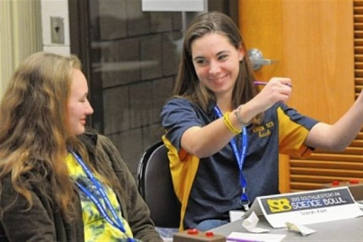 Correct Norwin High School's Sarah Kerr, right, pumps her fists after answering correctly, while her teammate Alexis Boytim looks on during the Southwestern Pennsylvania Science Bowl at the South Campus of CCAC on Saturday.