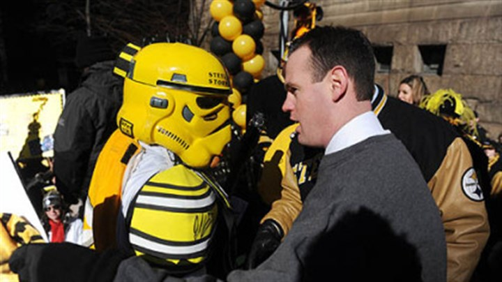 Costume contest winner Pittsburgh Mayor Luke Ravenstahl congratulates the Steel City Storm Trooper for winning a costume contest.