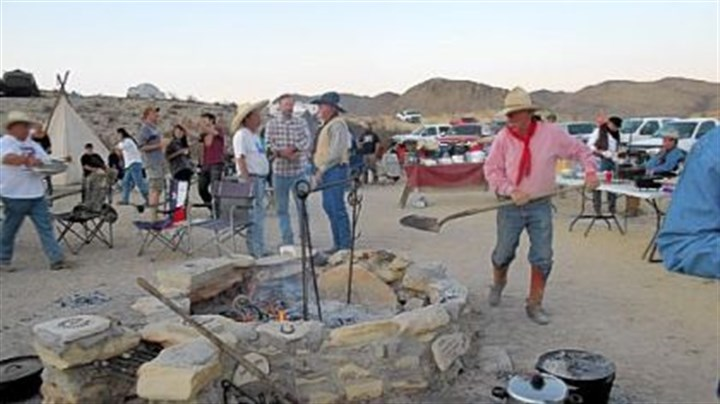 Cowboy camp Stoking the fire at Cowboy Camp during the Original Terlingua International Championship Chili Cook-Off in Terlingua, Texas.