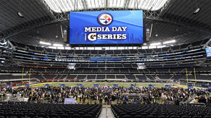 Cowboys Stadium The massive video screen hangs over Steelers players as they participate in Media Day Tuesday.