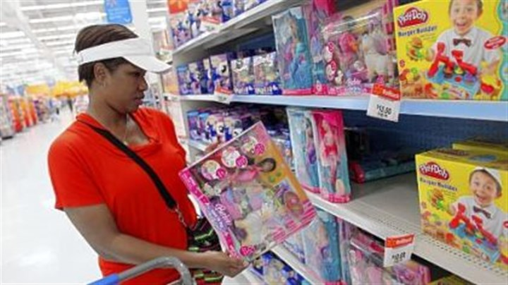 CPI Tanya Johnson shops for toys in the Walmart store in Pompano Beach, Fla. Wal-Mart stores Inc. announced that it would be bringing back its $10 toys section in all stores as they gear up for the holidays.