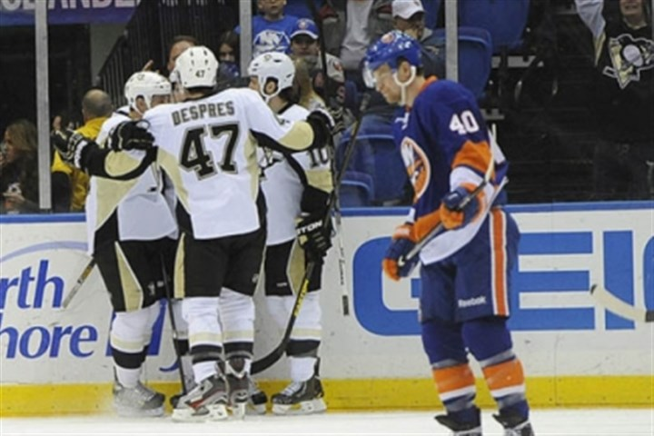 Craig Adams, Simon Despres and Tanner Glass The Penguins' Craig Adams, Simon Despres and Tanner Glass celebrate Joe Vitale's goal as the Islanders' Michael Grabner skates away in the second period.