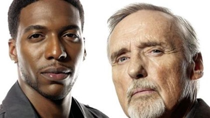 """Crash"" Jocko Sims, left, and Dennis Hopper clash in ""Crash."""