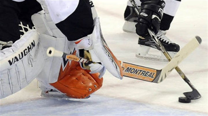 Crosby Penguins Sidney Crosby goes to the net against Flyers Martin Biron in the first period Sunday.