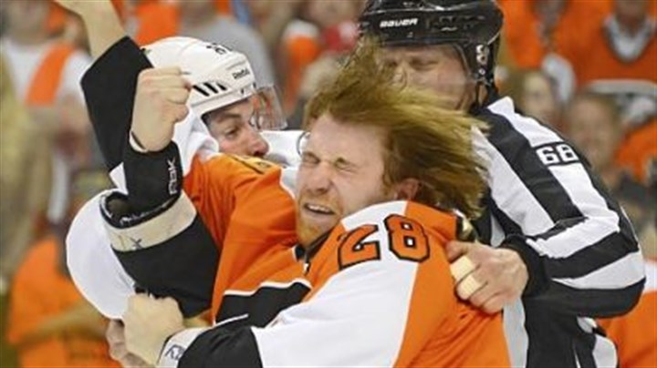 CrosbyPunch Sidney Crosby lands a punch to the face of Flyers center Claude Giroux in Sunday's game in Philadelphia.