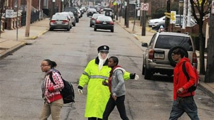 Crossing guard Cathy Gamble Crossing guard Cathy Gamble directs students across the 44th at Butler Street intersection in Lawrenceville during the morning commute.