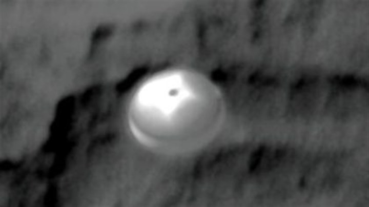 Curiosity Curiosity is photographed from NASA?s Mars Reconnaissance Orbiter as it rides its parachute toward the surface of the Red Planet. Details in the parachute, such as the band gap at the edges and the central hole, are clearly seen. It opened about 10 miles up, then separated with the craft?s heat shield at an altitude of a mile. From there, Curiosity made a powered descent.