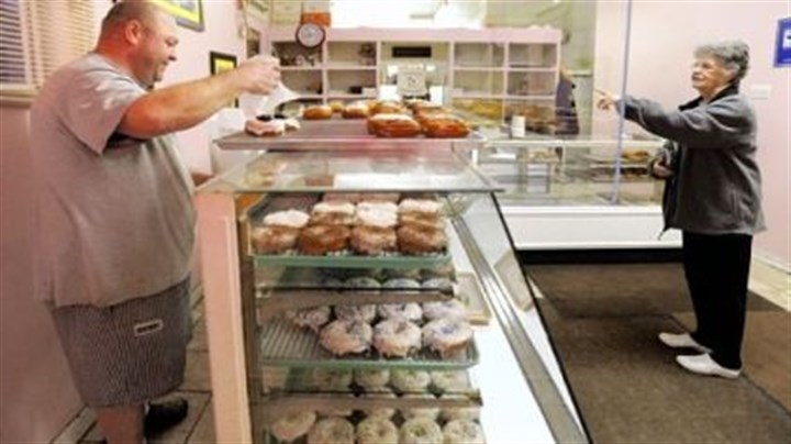 Customer Lillie Davis It's coconut, always coconut, when daily customer Lillie Davis comes calling at the Better-Maid Donut Co. on Steuben Street in Elliott. Ken Smith's shop has been a haven for doughnut lovers since he and brother Al Smith bought the business in 2004.